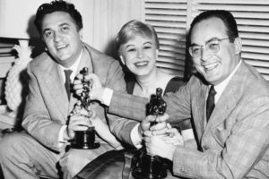 "FILE - In this March 28, 1957 file photo, Federico Fellini, left, his wife Giulietta Masina, and Dino De Laurentiis hold the Oscars awarded for ""La Strada"" in the Hollywood section of Los Angeles, Calif. De Laurentiis, a film impresario and producer of ""Serpico,"" ""Barbarella"" and ""Death Wish,"" died Wednesday, Nov. 10, 2010 at his home in Beverly Hills, Calif. He was 91. (AP Photo/ Ellis Bosworth, File)"